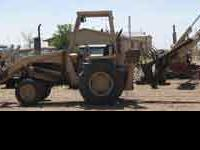 Older model industrial loader/backhoe. A real