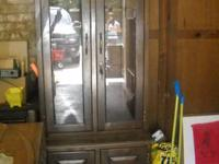 Wooden and glass locking gun cabinet. Looks like an