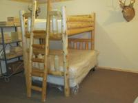 Log bunk beds for sale. Twin upper/Full lower. White