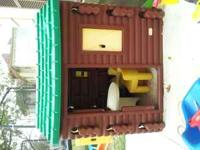 Outdoor log Cabin with 2 yellow chairs and built in