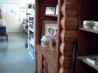 This is a home made china hutch made to look like a log