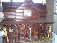 Nice doll house made of wood slats for your little