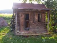 Log Playhouse. 7ft. deep, 7ft. high, and 8ft. wide.