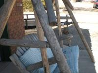 Nice log swing with a cushion, I would buy new cushions