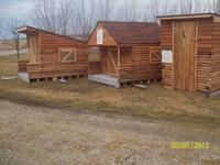 Have two NEW Log cabin buildings for sale. The middle