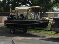 This boat is totally refurbished. New canopy, seats,