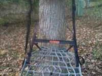 Lone Wolf climbing tree stand combo with hand climber.