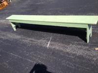 8 foot long wood bench. Sturdy, has paint splatters and