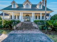 Stunning Waterfront Island Home! This 5 bedroom, 4.5