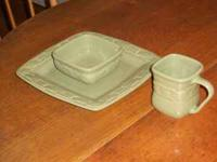 An 8 piece place setting including a plate, bowl, and