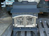 Very good refinished Lopi wood stove. 3/8 inch steel