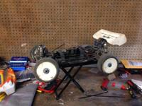 I HAVE A LOSI ELECTRIC 4WD RACING BUGGY FOR SALE. TEKIN