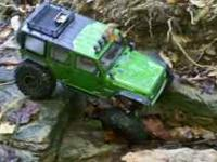 Losi night crawler with a jeep rubacon body and rock