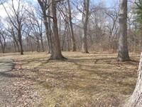 RIVERFRONT~PRIME LOCATION~JUST OVER 2~WOODED ACRES