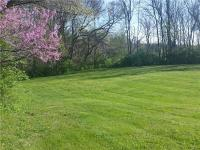 3/4 acre corner building lot in Country Club area.