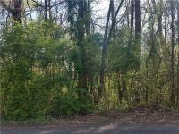 3/4 acre lot in the Country Club area. Wooded lot with