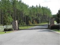 8 acre wooded lot in beautiful gated community perfect