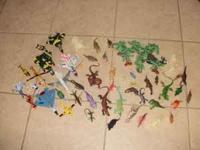 We have a lot of 90 plastic toy dinosaurs. A lot of