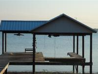 1-1/2 story cabin on major lake integrateded 2002. Open