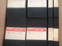 55 rigid archival tape cases, black color, labels