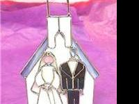 This is a brand new stained glass bride and groom