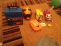 Lot of toys including hot wheels travel Case iron man