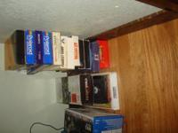 bunch of VHS tapes, forrest gump, ET, snow white, etc,