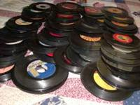 -45 rpm singles with portable record player that needs
