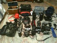 tons of camera equipment lenses, 4 or 5 cameras, speed