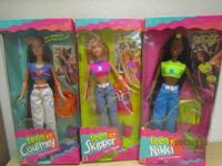 Lots of collectible Barbie dolls and clothing in truly