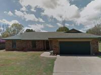 This is a 4 bedroom 2 bath 2 car garage located in