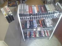 Collection of VHS movies with 3-shelf cart.  At least a