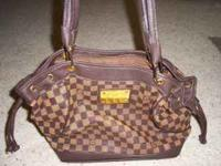 Unique large Louis Vuitton. This bag is a replica