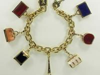 Original 18K Gold Louis Vuitton charm bracelet with