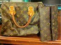 Louis Vuitton Top handle Speedy bag With LV lock and