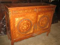 A Louis XV bronze mounted & marquetry inlaid commode.