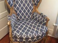 Lovely antique Louis XV wing chair. Upholstered in