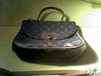This is an authentic Louis Vuitton, I believe from the