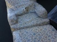 This custom covered lounge chair & ottoman selected for
