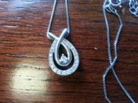 I am selling a silver necklace with 1/5 CTW in Diamonds