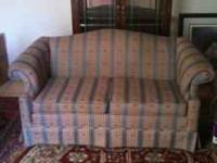 We have a country style love seat in great condition!
