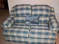 Love Seat in great condition--Call  for mor information