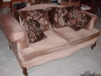 This is a vintage looking love seat. The pillows on the