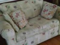 FOR SALE IS A LOVE SEAT THAT MAKES INTO A SLEEPER. MY