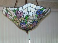 Check out this gorgeous large fixture to hang over your