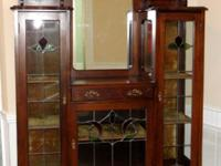 This circa 1890-1900 large Victorian solid wood china