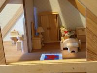 Lovely doll house....looks new...all wood.  Comes with