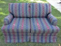 Fabulous looking loveseat in prestine condition. Rarely