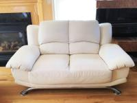 Used loveseat. Some wear. Cream color.Length: 63