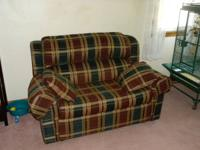 nice love seat in good condition. Makes into single bed